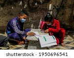Small photo of Children study outside their home, after a schools a closed run by the United Nations (UNRWA). Amid new measures to counter the spread of COVID-19 coronavirus, in Gaza Strip, on April 6, 2021.