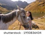 A Woman With A Horse In A...