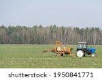 Blue Tractor Spraying...
