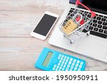 Small photo of Laptop, mobile phone, calculator and shopping cart model with a lock imply the concept of online shopping security