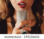 Beautiful Girl Sings Into A...
