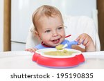 cute toddler boy eating at a... | Shutterstock . vector #195190835