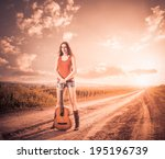 artistic woman at sunset road | Shutterstock . vector #195196739