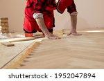 Handyman installing wooden...
