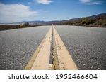 Cracked Asphalt Road In The...