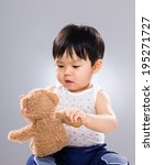 asian little boy holding toy... | Shutterstock . vector #195271727