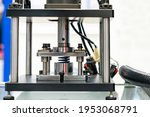 Small photo of hydraulic press machine during metal spring test property durability endurance fatigue pressure force etc.