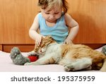 Stock photo tiny boy playing with ginger cat house 195375959