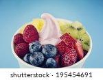 frozen yogurt with berries   Shutterstock . vector #195454691