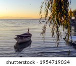 Boat In The Lake With Sunset