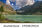 mountain lake on summer evening ... | Shutterstock . vector #1954819414