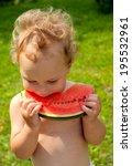cute boy eating water melon...   Shutterstock . vector #195532961