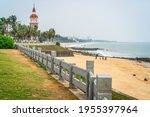Haikou beachside panorama with the Guanhaitai clock tower in Haikou Hainan China