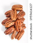 Small photo of Pecan Caramelized. Caramelized pecans on a white plate. Fried pecan.