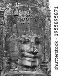 Monochrome anciant temple scultpured face with headress and broken nose