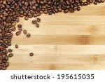 roasted coffee beans on wood... | Shutterstock . vector #195615035
