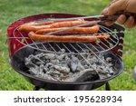 man preparing sausage on... | Shutterstock . vector #195628934