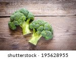 fresh broccoli on the wooden... | Shutterstock . vector #195628955