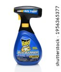 Small photo of IRVINE, CA - SEPTEMBER 15, 2014: A bottle of Raid Max Bug Barrier. Raid is the brand name of a line of insecticide products produced by S. C. Johnson and Son, first launched in 1956.