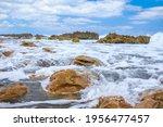 Waves Crashing On The Rocks On...
