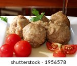 meatballs in onion sauce and cherry tomatoes - stock photo