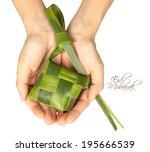 hand held muslim ketupat  rice... | Shutterstock . vector #195666539