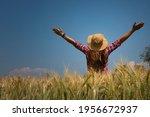 Rear View Of Woman Farmer ...