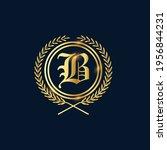 golden letter r laurel wreath... | Shutterstock .eps vector #1956844231