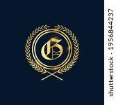 golden letter g laurel wreath... | Shutterstock .eps vector #1956844237