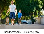 Stock photo a father walking with his dog and his son in the suburbs 195763757