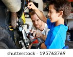 a boy helping his dad with... | Shutterstock . vector #195763769