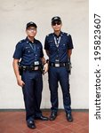 Small photo of SINGAPORE - 10 FEBRUARY: Unidentified police on patrol in Little India on February 10, 2014 in Singapore. Singapore's crime rate hit a 30 year low in 2013 with total crime cases falling 4.3 per cent.