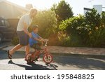 young boy learning to ride... | Shutterstock . vector #195848825