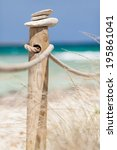 stones balanced on wooden... | Shutterstock . vector #195861041