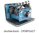 Multimedia concept. Laptop, camera , headphones and video attributes. 3d - stock photo