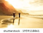 Surfer Silhouettes On The Beach ...