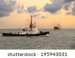 Cargo Ship And Tugboat In The...