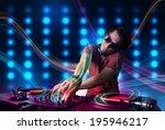 attractive young dj mixing... | Shutterstock . vector #195946217