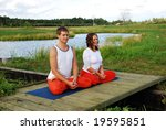 happy couple meditating together | Shutterstock . vector #19595851