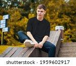 black t shirt template on a guy ... | Shutterstock . vector #1959602917