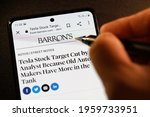 Small photo of PENANG, MALAYSIA - 31 MAR 2021: Android phone user using Barron's News apps on his smartphone. Barron's is an American weekly magazine and newspaper published by Dow Jones and Company.