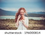 Beautiful Woman Enjoying Field...