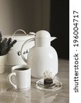 white teapot is on the table | Shutterstock . vector #196004717