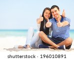 young couple on the beach show... | Shutterstock . vector #196010891
