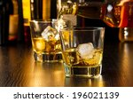 barman pouring whiskey behind... | Shutterstock . vector #196021139