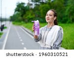 Fitness Woman Drinking Water...
