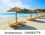 sunbeds with umbrellas on porto ... | Shutterstock . vector #196083779