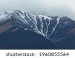 Snow Capped Peaks And Dark...