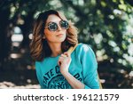young girl posing in the park | Shutterstock . vector #196121579