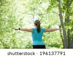 young woman stretching in the... | Shutterstock . vector #196137791